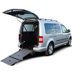 Picture of accessible van with the boot open and ramp