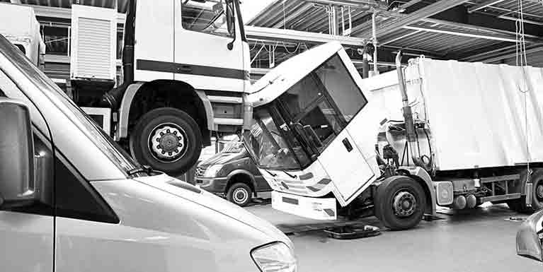 Picture of HGVs in a repair shop