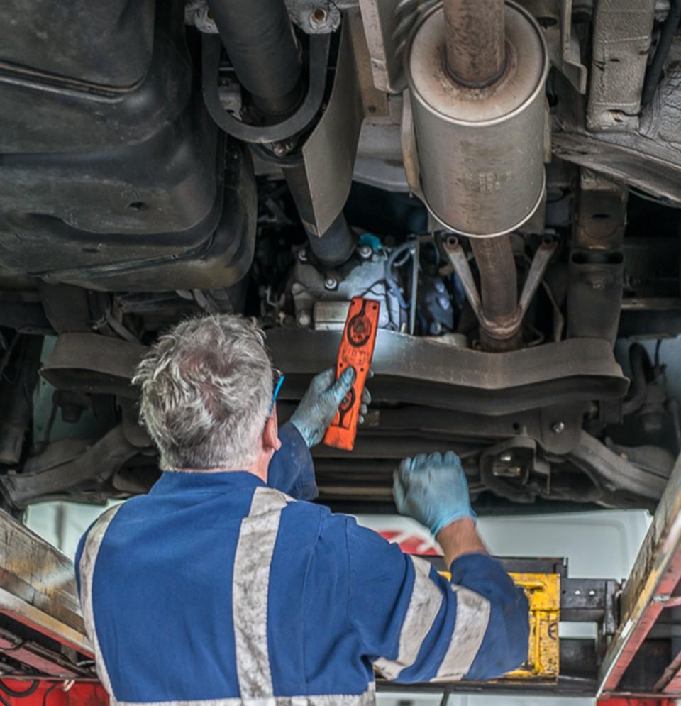 Picture of a mechanic repairing a van