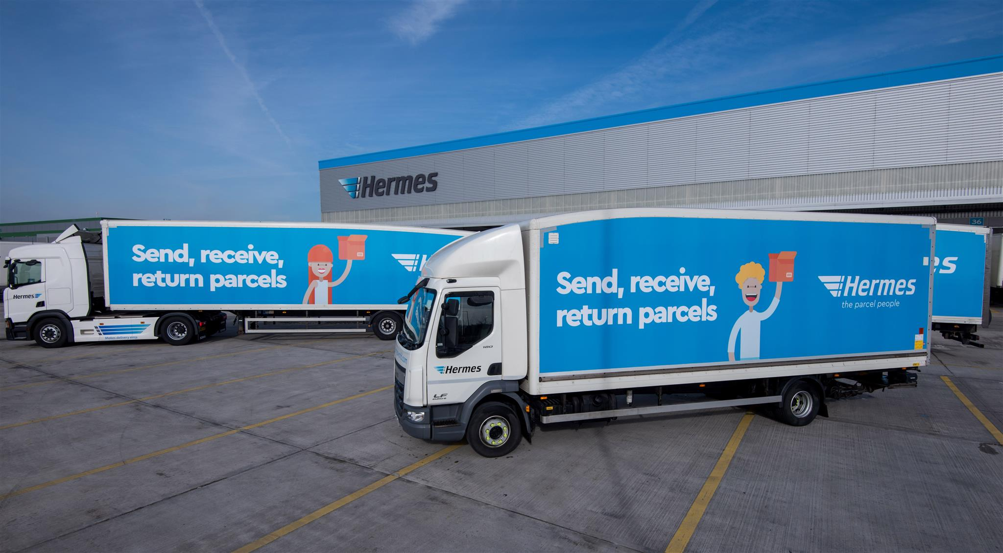 Picture of two Flex-E-Rent HGVs with Hermes branding
